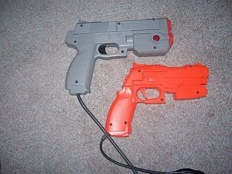 Light gun shooter - Popular GunCon light guns. The bright orange illustrates the toy-like appearance of most light guns, whereas the grey example appears more realistic.