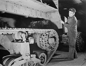 Diebold Nixdorf - Pictured is the body of a scout car, manufactured by Diebold, being installed at a Diebold plant in Canton, Ohio in 1941.