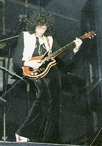 Brian May performing live with Queen in Hannover, Germany, 1979.