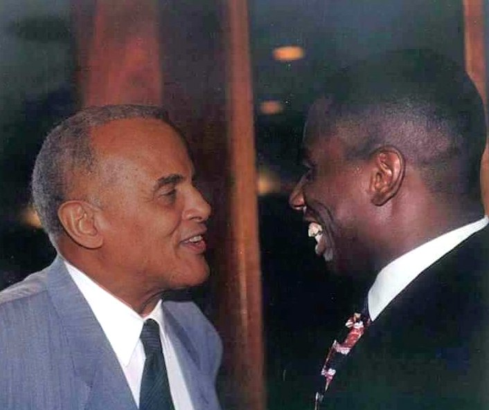 Harry Belafonte (left) with opera star Stacey Robinson in 1988