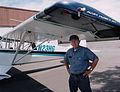 Harry T Garland with his Aviat Husky N23HG (2004).jpg