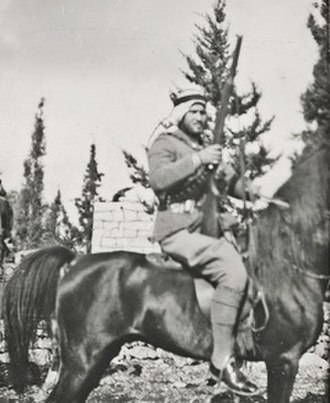 Hasan Salama - Salama with rifle in hand and on horseback during the revolt in Mandatory Palestine, 1939