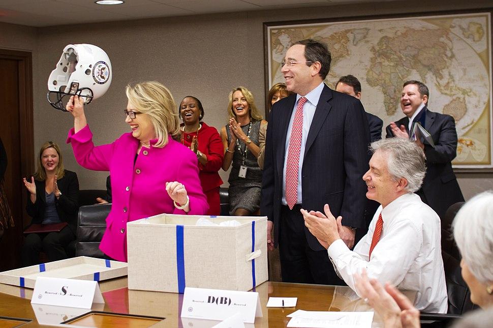 Hillary Clinton receives a football helmet