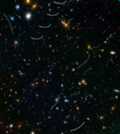 Hubble Sees Nearby Asteroids Photobombing Distant Galaxies (26341511059).png