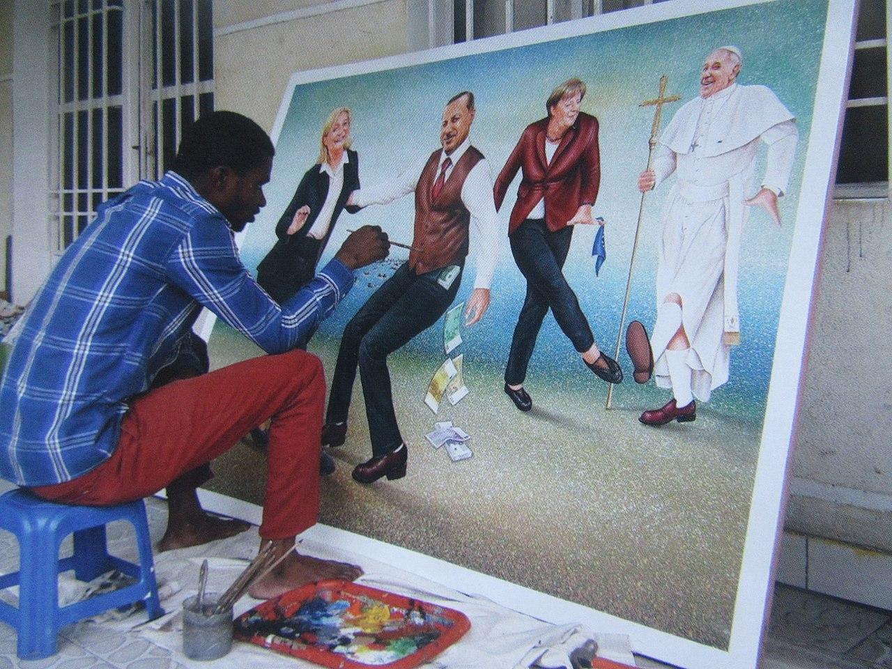 IMG 5374 Le peintre Amani Bodo réalisant une toile en 2017.jpg