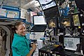 ISS-24 Shannon Walker in front of the robotic workstation.jpg