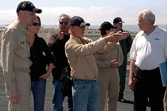 Ian Bryce - Bryce (center) scouts filming locations on the flight deck of the USS John C. Stennis for Transformers: Revenge of the Fallen in September 2008.