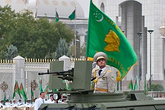 Armed Forces of Turkmenistan - Soldier with the flag of the Turkmen Armed Forces