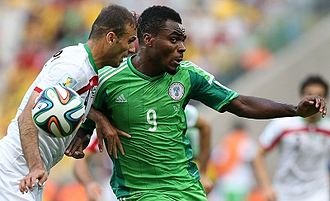 Emmanuel Emenike - Emenike (right) playing for Nigeria against Iran at the 2014 FIFA World Cup