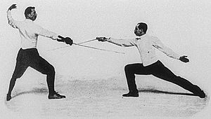 Fencing at the 1900 Summer Olympics - Italo Santelli (left) and Jean-Baptiste Mimiague competing in the masters foil event.  Mimiague won both bouts between the two.