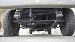 JGSDF Power Supply Vehicle(Nissan Safari, 04-1569) chassis front low-angle view at Camp Akeno November 4, 2017.jpg