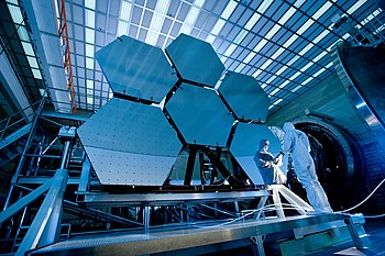 This is a picture of the James Webb Space Telescope. Note the small triangle next to this caption.