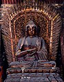 Jin Dynasty statue of Ratnasambhava (寶生如來 or 宝生如来 Bǎoshēng Rúlái), one of Five Tathagathas (五方佛 Wǔfāngfó) or Five Wisdom Buddhas (五智如来 Wǔzhì Rúlái) at Shanhua Temple (善化寺) in Shanxi, China.jpg