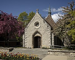 The 15th-century St. Joan of Arc Chapel was initially built in the village of Chasse-sur-Rhône, France. Originally called the Chapelle de St. Martin de Seyssuel, it is said to have been the place at which Joan of Arc prayed in 1429 after she had met King Charles VII of France. The present name was given to the chapel when Gertrude Hill Gavin, the daughter of an American railroad magnate, had the derelict building dismantled, transported to America and rebuilt beside her French Renaissance–style château in Brookville, New York, in 1927. The chapel was undamaged when the château burned down in 1962, and was later given to Marquette University in Milwaukee, Wisconsin, once more being transported stone by stone.