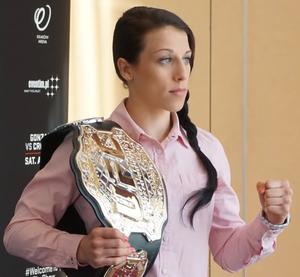 Joanna Jędrzejczyk - Jędrzejczyk posing with the UFC Women's Strawweight Championship