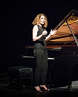 Joanna McGregor speaking at a piano recital (cropped).jpg
