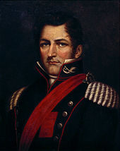 Half-length painted portrait depicting a man with dark blond hair wearing a military tunic with gold epaulets, red piping, a red sash and upraised collar bearing cavalry insignia