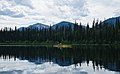 Kayaker on Skoi Lake in Bowron Lake Provincial Park, BC (DSCF3638).jpg