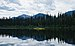 Kayaker on Skoi Lake in Bowron Lake Provincial Park, BC (DSCF3638).jpg