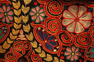 Chain stitch - Traditional embroidery in chain stitch on a Kazakh rug, contemporary.