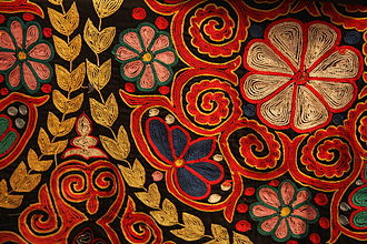 Embroidery - Traditional embroidery in chain stitch on a Kazakh rug, contemporary.