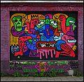 Keith Haring-like Mural in Tweebruggenstraat in Gent - panoramio.jpg