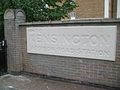 Kensington Olympia stn east entrance carving.JPG