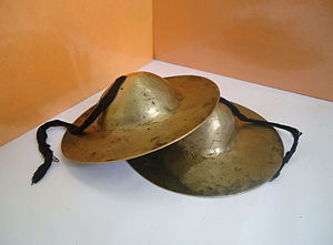 Cymbal - A type of crash cymbals used in Assam, India. It is similar to Khartal. This instrument is used in Assamese dances called Bihu.