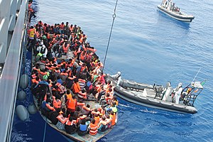 European migrant crisis - Operation Triton: Irish Naval Service personnel from the LÉ Eithne rescuing migrants, 15 June 2015