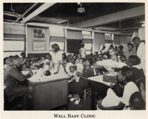 A room filled with young children sitting at desks.