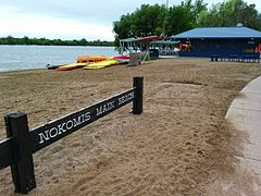 Lake Nokomis main beach sign, boats, and Sandcastle restaurant.jpg