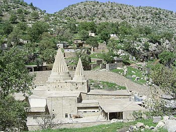 Conical roofs characteristic of Yazidi sites m...