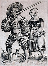 Landsknecht with his Wife. Etching by Daniel Hopfer. Note the huge zweidhänder sword over his shoulder, and the smaller Katzbalger sword at his hip, both emblematic of the Landsknecht.