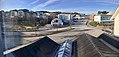 Leirvik, Stord, Norway, seen from Grand Hotell. Heimebaserte tenester, Esso petrol station, Vikabrekko (fylkesveg 544), Stord town hall (rådhus), bus station, etc. Distorted, compressed panorama 2018-03-10.jpg