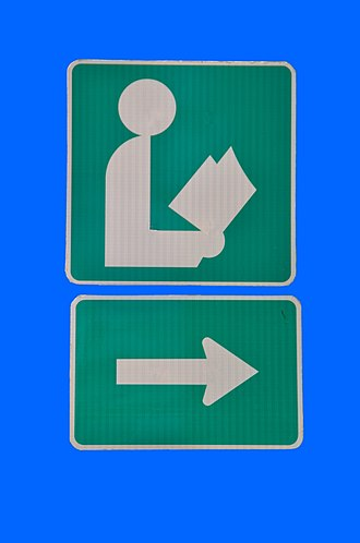 Public libraries in North America - Street sign commonly used to point the way to a public library