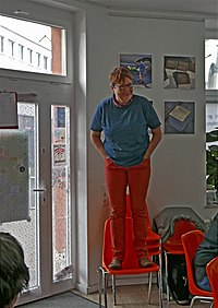 Unconventional lecture solutions became necessary in Cologne as one of our volunteers delivered an introductory speech standing on a chair.