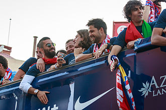 Arda Turan - Turan (in sunglasses) on Atlético's victory parade after winning La Liga in 2014