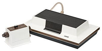 The Magnavox Odyssey was the first video game console, released in 1972. Magnavox-Odyssey-Console-Set.jpg