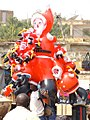 Man with Santa balloons, Burkina Faso, 2009.jpg