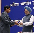 Manmohan Singh gave away the President's Police Medal to Shri Chattar Singh Paarcha, Joint Director, New Delhi for distinguished services on the occasion of Independence day-2007, at the DGPsIGPs Conference-2008.jpg