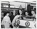 Mark Bortman with an unidentified woman and unidentified men standing behind an iron lung (12618158115).jpg