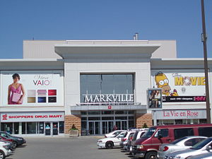 Markville Shopping Centre - Markville Shopping Centre entrance. Promotions for Sony and HMV stores are on the top while Shoppers Drug Mart and La Vie en Rose are on the bottom.
