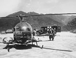 Medics carry wounded soldier to H-13 helo KOrea 1953.JPEG