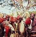 Men posing in their Kpon dance outfits- Miehet kpon-tanssiasuissa (16329272288).jpg