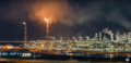 Mesaieed Industrial Area panoramic view at night.png