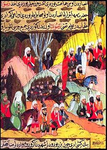 Mohammed (in green, lower left) marching to the Battle of Uhud. From the Siyer-i Nebi.jpg