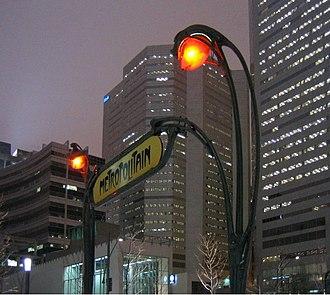 Quartier international de Montréal - Complexe Maisonneuve and the back of Place de la Cité internationale, seen at night from Victoria Square.