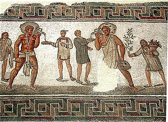 Slavery in ancient Rome - Roman mosaic from Dougga, Tunisia (2nd century AD): the two slaves carrying wine jars wear typical slave clothing and an amulet against the evil eye on a necklace; the slave boy to the left carries water and towels, and the one on the right a bough and a basket of flowers