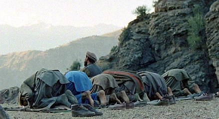 Praying Muhjahideen in Kunar Province, Afghanistan (1987) Mujahideen prayer in Shultan Valley Kunar, 1987.jpg