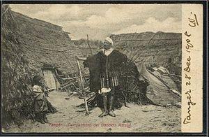 Mulai Ahmed er Raisuni - A goumi standing guard in the camp of Mulai Ahmed er Raisuli in Tangier, Morocco.